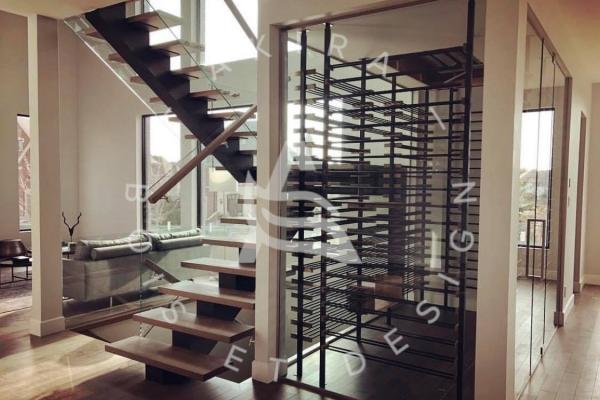 escalier-sur-mesure-laurentides-limon-central-acier-palier-structure-rampe-mur-garde-corps-verre-akira-logo-197C07D04-DC21-031C-2E65-A610EA9D9735.jpg