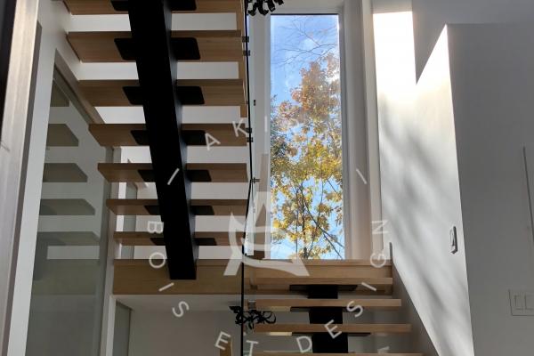 escalier-sur-mesure-laurentides-limon-central-acier-rampe-garde-corps-verre-akira-logo-217043090-F6A0-B7EB-EB27-2DA98464C2A3.jpg