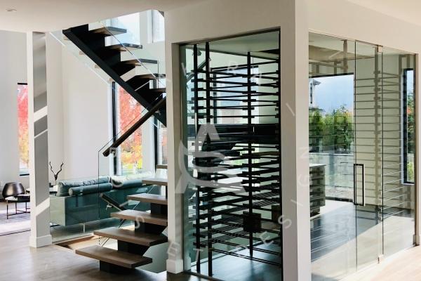 escalier-sur-mesure-laurentides-limon-central-acier-palier-structure-rampe-mur-garde-corps-verre-akira-logo-2C7A6CCA3-3C22-7FD1-C25A-F6CB73594703.jpg