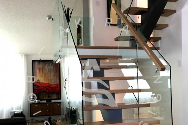 escalier-sur-mesure-laurentides-limon-central-rampe-verre-akira-logo-3D0E8B3A0-B4D3-6B89-DFBB-07BBBA81DCB7.jpg